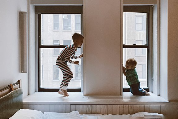 two-kids-playing-beside-glass-windows-3273851.jpg